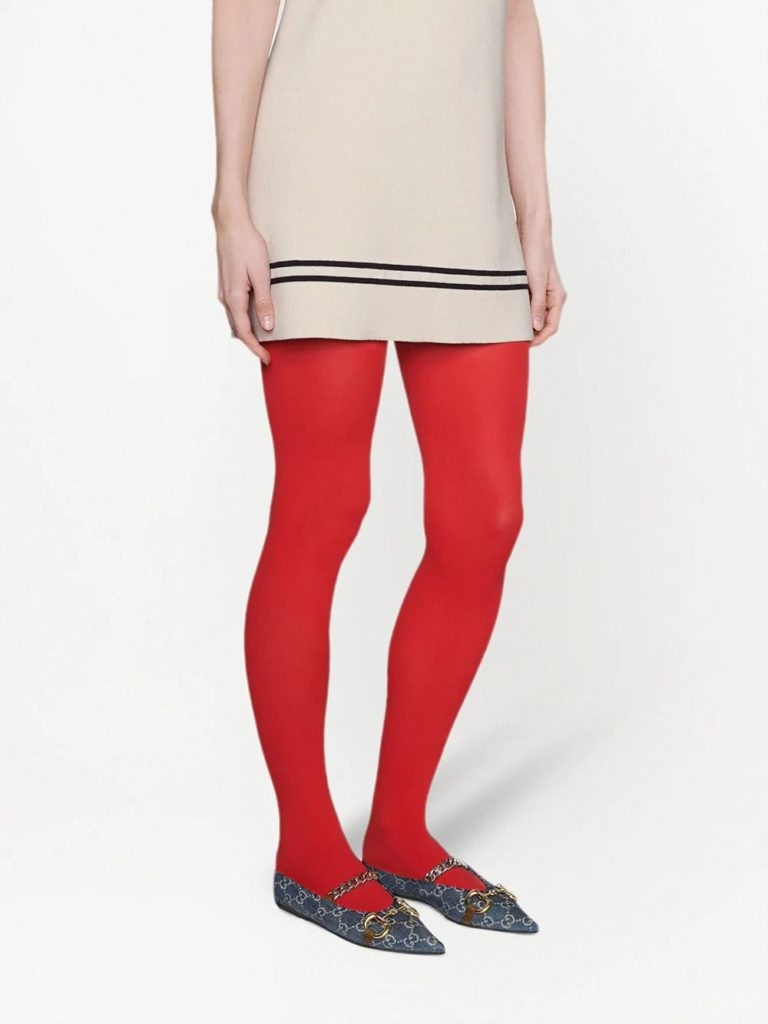 Woman with red tights wearing flat shoes