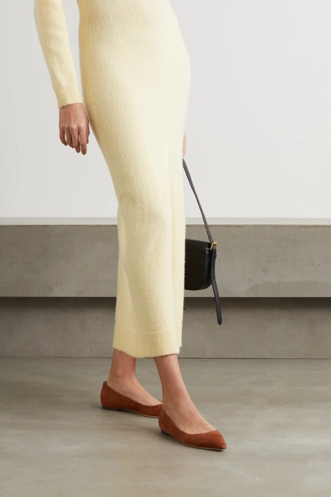 Woman wearing brown flat shoes