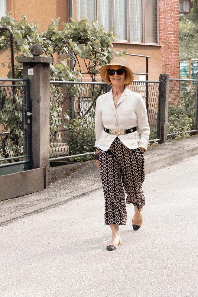 Woman with a hat walking down the street
